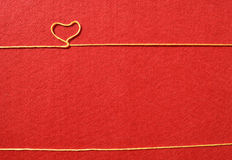 Ribbon greeting and hearts on red background Stock Photo