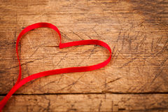 Ribbon heart on wooden table Stock Image