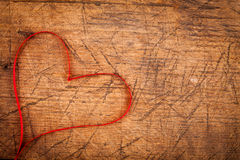 Ribbon heart on wooden table Royalty Free Stock Images