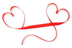Ribbon hearts. Red silk ribbon in the shape of two hearts Stock Image