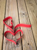 Ribbon hearts against grungy wooden background Royalty Free Stock Photography