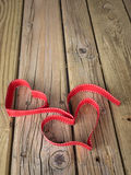 Ribbon hearts against grungy wooden background Stock Image