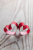 Ribbon hearts on wooden background Royalty Free Stock Photo