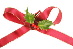 Ribbon and holly Royalty Free Stock Image