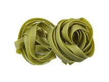 Ribbon-macaroni - isolated. Two nests of green ribbon-macaroni isolated on white Stock Photography