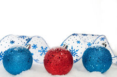 Ribbon and ornaments. Blue and red ribbon and ornaments on white background Royalty Free Stock Photos