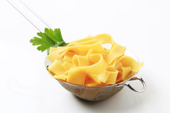 Ribbon pasta. Cooked ribbon pasta in a metal sieve royalty free stock image