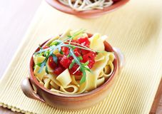 Ribbon pasta and peeled tomato Royalty Free Stock Photo