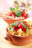 Ribbon pasta and peeled tomato Royalty Free Stock Photography