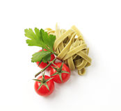 Ribbon pasta and tomatoes Royalty Free Stock Image