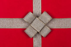Ribbon on a red background Christmas gift Royalty Free Stock Images