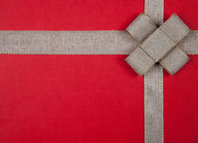 Ribbon on a red background Christmas gift Royalty Free Stock Image