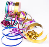 Ribbon reel with colorful ribbons and bows. A reel of colorful ribbons and bows on a white background Stock Photo