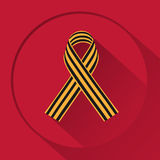 Ribbon Saint George. On a red background Royalty Free Stock Photos
