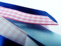 Ribbon samples close up pink and blue. Gingham Stock Images