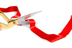 Ribbon and scissors on white background. Ceremonial red tape cutting. Red ribbon and scissors on white background. Ceremonial red tape cutting royalty free stock images