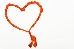 Ribbon in shape of a heart. Red ribbon in shape of a heart Stock Photo