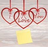 A ribbon in the shape of a heart. Empty Yellow sheet of paper fo. R notes. Sticker. I love you. Red bow. Greeting card or invitation for a holiday. St. Valentine Royalty Free Stock Photos