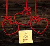 A ribbon in the shape of a heart. Red bow. Greeting card or invi. Tation for a holiday. St. Valentine`s Day. Love. Empty place for text or advertising. Vector on Stock Image