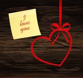 A ribbon in the shape of a heart. Yellow sheet of paper for note. S. Sticker. I love you. Red bow. Greeting card or invitation for a holiday. St. Valentine`s Day Stock Photos