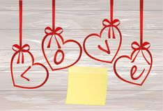 A ribbon in the shape of a heart. Yellow sheet of paper for note. S. Sticker. I love you. Red bow. Greeting card or invitation for a holiday. St. Valentine`s Day Royalty Free Stock Photos