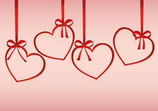 A ribbon in the shape of a hearts. Red bows. Greeting card or invitation Royalty Free Stock Photos