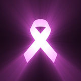 Pink ribbon shining bright light flare Stock Photography