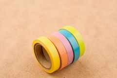 Ribbon Tapes. Color ribbon tapes on a wooden background royalty free stock images