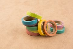 Ribbon Tapes. Color ribbon tapes on a wooden background stock photo