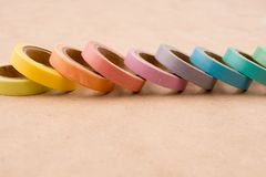 Ribbon Tapes. Color ribbon tapes on a wooden background royalty free stock photos