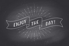 Ribbon with text Enjoy the Day on chalkboard Royalty Free Stock Images