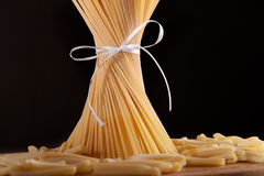 Ribbon tied bunch of spaghetti pasta Royalty Free Stock Photography