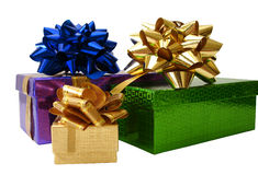 Ribbon tied gift boxes over white background Stock Image