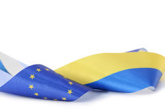 Ribbon with Ukrainian and European union flags isolated on white Royalty Free Stock Images