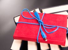 Ribbon from the usb cable on red book Royalty Free Stock Photos