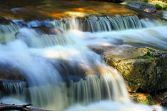 Ribbon water, stream, stones, reflections, nature Royalty Free Stock Photos