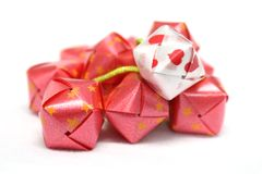 Ribbon wrapped coins red box. Es Stock Photography