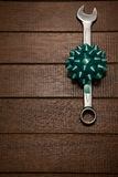 Ribbon with wrench on wooden table Stock Photo