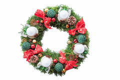 With ribbons, baubles and candles decorated evergreen yew wreath Royalty Free Stock Photography