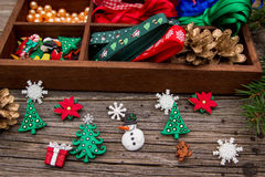 Ribbons, beads, toys, Christmas crafts in a wooden box. Stock Photo