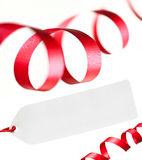 Ribbons and blank price tag,  on white. Stock Images