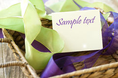 Ribbons in a Brown Basket with a Blank Card Stock Photos