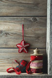 Ribbons and Christmas ornaments on wood shelf Stock Photo