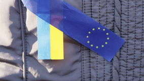 Ribbons EU and Ukraine. Demonstrator with ribbons EU and Ukraine stock footage