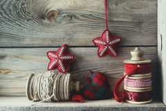 Ribbons and holiday ornaments on wood shelf Royalty Free Stock Photo