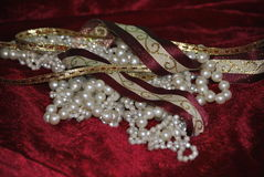 Ribbons and pearls. Gold and Burgundy ribbons with pearls for Christmas holiday Royalty Free Stock Photos
