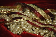 Ribbons and pearls. Gold and Burgundy ribbons with pearls for Christmas holiday Royalty Free Stock Images