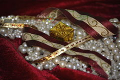 Ribbons and pearls. Gold and Burgundy ribbons with pearls for Christmas holiday Stock Photo
