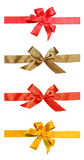 Ribbons of red  and gold color of gift and bow. It is isolated on a white Stock Image