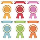 Ribbons and rosettes Stock Images